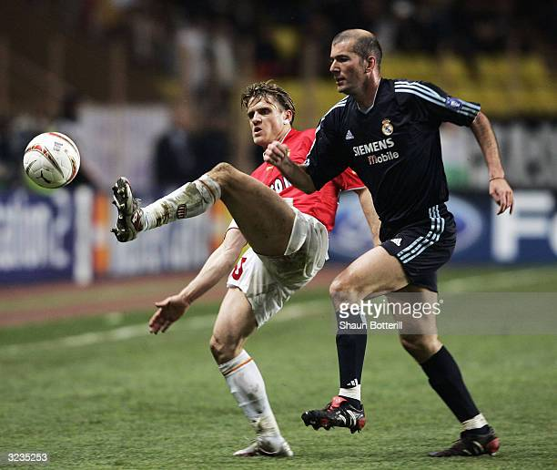 Zinedine Zidane of Real Madrid challenges Jerome Rothen of Monaco during the final whistle of the UEFA Champions League Quarter Final Second Leg...