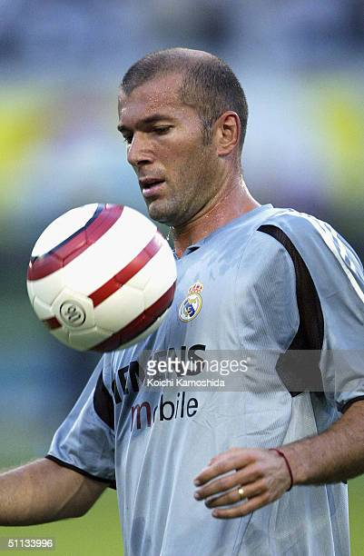 Zinedine Zidane of Real Madrid controls the ball during the warmup before the Tokyo Verdy 1969 v Real Madrid preseason friendly match played at the...