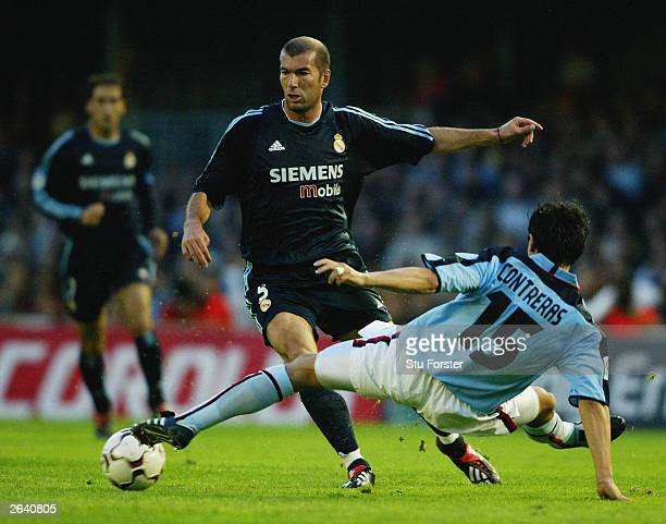 Zinedine Zidane of Real Madrid evades a challenge from Pablo Contreras of Celta Vigo during the Primera Liga match between Celta Vigo and Real Madrid...