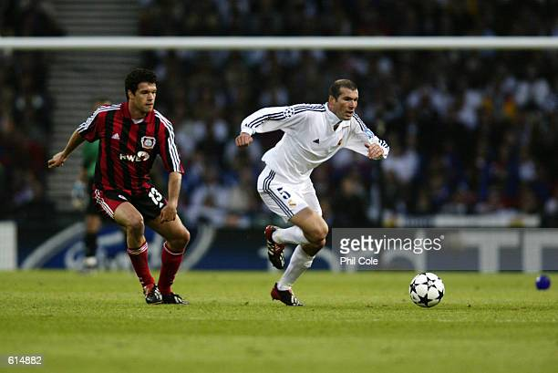Zinedine Zidane of Real Madrid goes past Michael Ballack of Bayer Leverkusen during the UEFA Champions League Final played at Hampden Park, in...