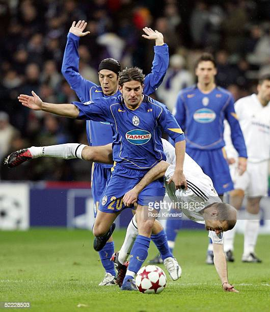 Zinedine Zidane of Real Madrid is fouled by Manuele Blasi of Juventus during the UEFA Champions League match between Real Madrid and Juventus at The...