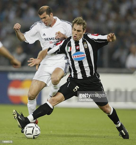 Zinedine Zidane of Real Madrid is tackled by Igor Tudor of Juventus during the UEFA Champions League semi final second leg match between Juventus and...