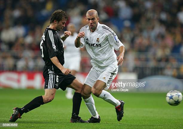 Zinedine Zidane of Real Madrid is tackled by Roar Strand of Rosenborg during the UEFA Champions League group F match between Real Madrid and...