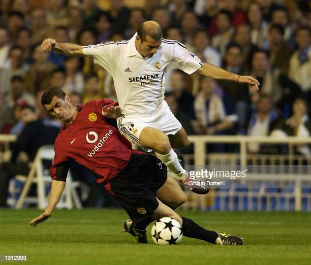 Zinedine Zidane of Real Madrid jumps over a tackle from Roy Keane of Manchester United during the UEFA Champions League quarterfinal first leg match...
