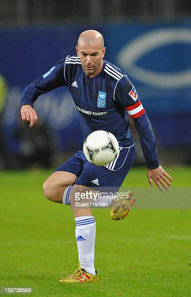 Zinedine Zidane of the friends team in action during the charity Match Against Poverty between HSV Allstars v Ronaldo Zidane Friends at the Imtech...
