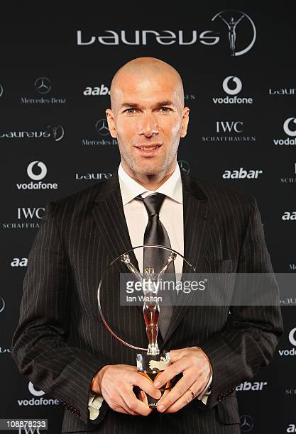 """Zinedine Zidane poses with his award for """"Laureus Lifetime Achievement Award"""" in the winners studio at the 2011 Laureus World Sports Awards at the..."""