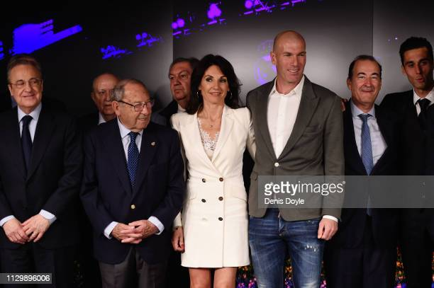 Zinedine Zidane poses with his wife Veronique Zidane after being announced as new Real Madrid head coach at Estadio Santiago Bernabeu on March 11...