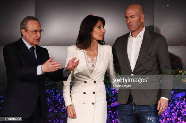 Zinedine Zidane poses with his wife Veronique Zidane and Florentino Perez President of Real Madrid after being announced as new Real Madrid head...