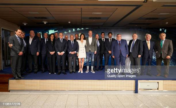 Zinedine Zidane poses with his wife Veronique Zidane Florentino Perez President of Real Madrid and Real Madrid members after being announced as new...