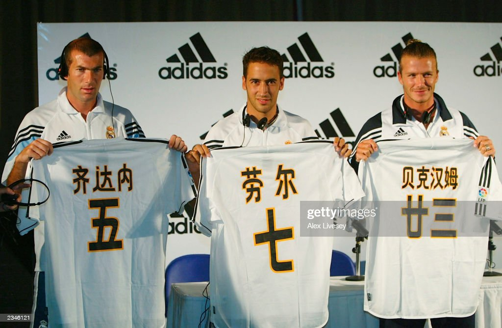 Zinedine Zidane, Raul and David Beckham of Real Madrid are presented with their shirts with their names in chinese during an adidas football launch on July 30, 2003 at the Harbour Plaza Hotel in Kunming, China.