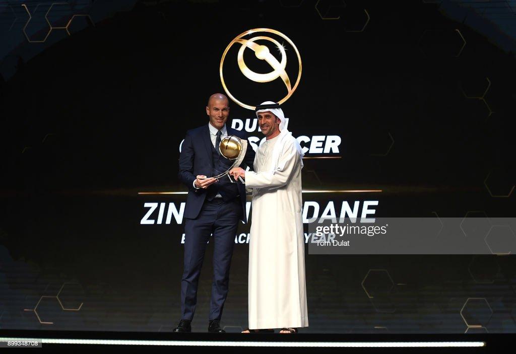Zinedine Zidane receives Best Coach of the Year Award from Abdullah Khalifa Al Merri during the Globe Soccer Awards 2017 on December 28, 2017 in Dubai, United Arab Emirates.