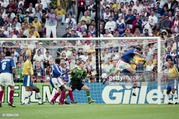 Zinedine Zidane scores his goal during the Soccer World Cup Final between Brazil and France on July 12 1998 in Paris Saint Denis France Eric Renard /...