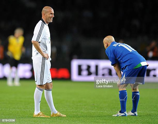Zinedine Zidane smiles with Enrico Ruggeri during the charity football game between National Singers and Team Ale 10 on May 18 2009 in Turin Italy on...