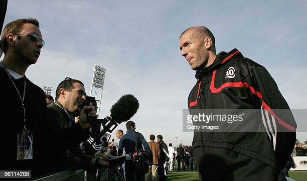 Zinedine Zidane talks to journalists on the pitch during the Adidas press launch of the new Predator Football boot on November 3, 2005 in Las Rozas,...