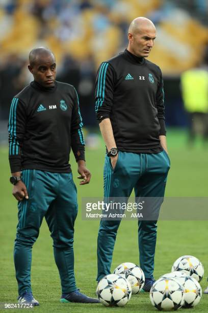 Zinedine Zidane the head coach / manager of Real Madrid looks on during the Training Session at the NSC Olimpiyskiy Stadium ahead of the UEFA...