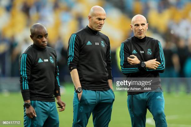 Zinedine Zidane the head coach / manager of Real Madrid looks on with his coaching staff during the Training Session at the NSC Olimpiyskiy Stadium...