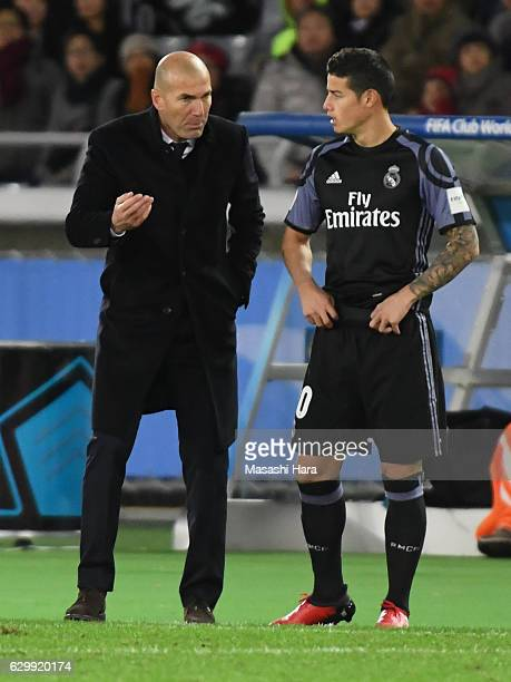 Zinedine Zidanecoach and James Rodriguez of Real Madrid look on during the FIFA Club World Cup Semi Final between Club America and Real Madrid at...