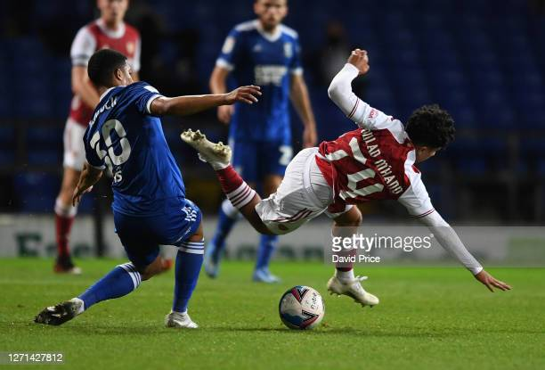 ZineEddine Oulad M'Hand of Arsenal is fouled by Myles Kenlock of Ipswich during the Leasingcom Cup match between Ipswich Town and Arsenal U21 at...