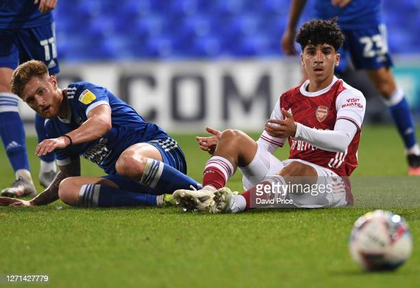 ZineEddine Oulad MHand of Arsenal looks on after being fouled by Teddy Bishop of Ipswich during the Leasingcom Cup match between Ipswich Town and...