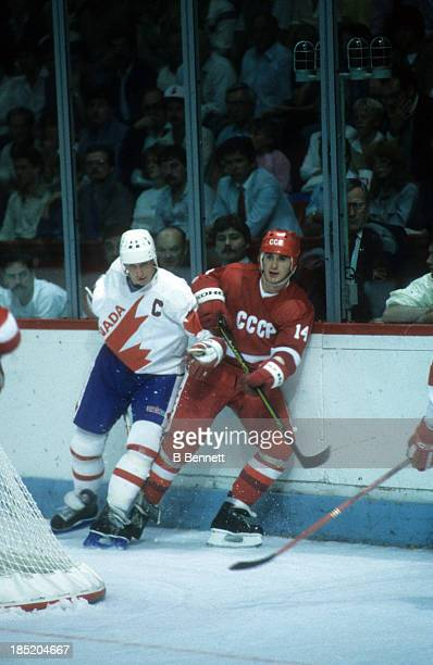 Zinetula Bilyaletdinov of the Soviet Union is checked by Wayne Gretzky of Canada during the 1981 Canada Cup Final on September 13 1981 at the...