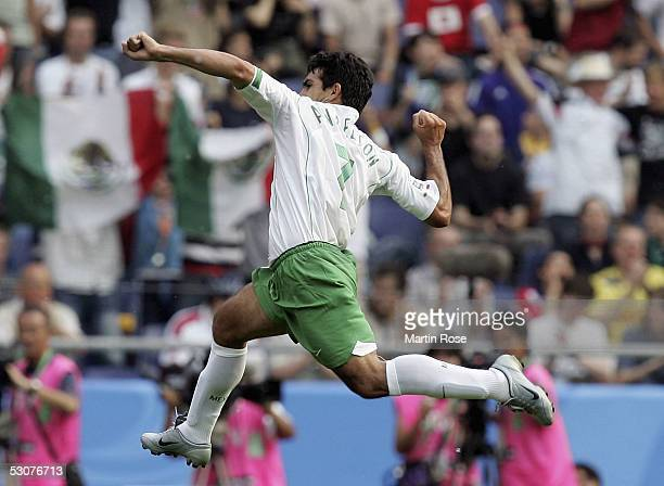 Zinha of Mexico celebrates scoring the first goal during the FIFA Confederations Cup Match between Japan and Mexico at the AWD Arena on June 16 2005...