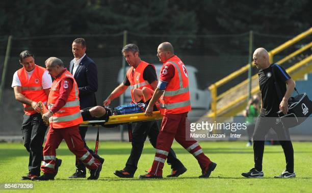 Zinho Vanheusden of FC Internazionale is helped from the pitch after sustaining an injury during the UEFA Youth League Domestic Champions Path match...