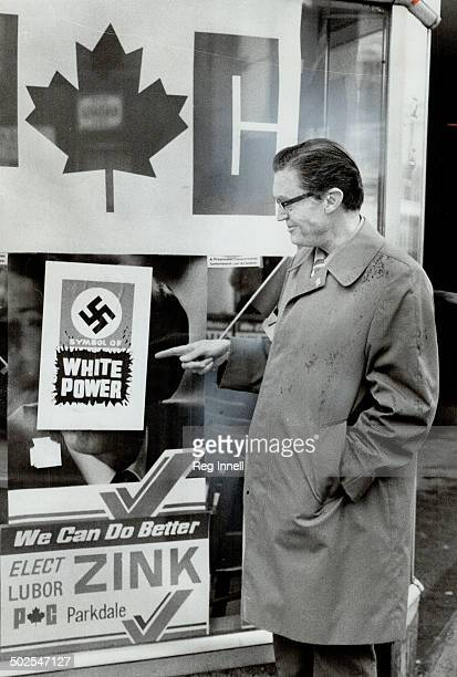 Zink's Headquarters Defaced The Conservative candidate in Parkdale Lubor Zink examines a swastika sign defacing his headquarters on Queen St W near...