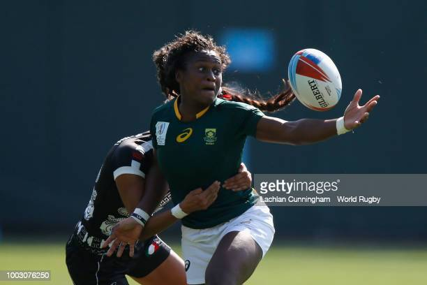 Marina Bravo of Spain is tackled by Kayla Moleschi and Charity Williams of Canada during day two of the Rugby World Cup Sevens at ATT Park on July 21...