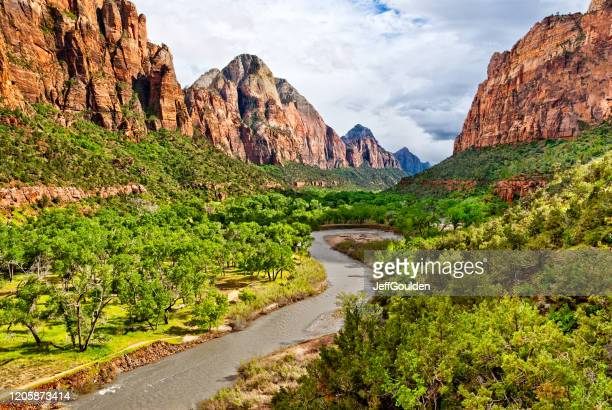 zion canyon and the meandering virgin river at dusk - jeff goulden stock pictures, royalty-free photos & images