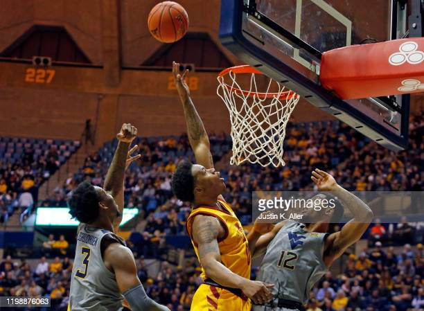 Zion Griffin of the Iowa State Cyclones battles for a rebound against Gabe Osabuohien and Taz Sherman of the West Virginia Mountaineers at the WVU...