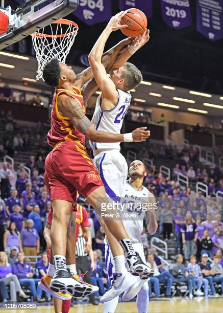 Zion Griffin of the Iowa State Cyclones blocks the shot of Pierson McAtee of the Kansas State Wildcats during the second half at Bramlage Coliseum on...