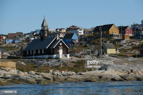 Zion Lutheran Church, built in 1779, stands on Disko Bay on August 04, 2019 in Ilulissat, Greenland. As the Earth's climate warms summers have become...