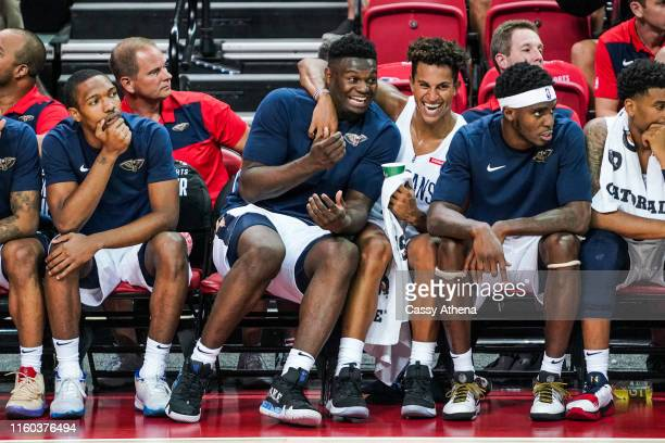 Zion Williamson and Frank Jackson of the New Orleans Pelicans laugh together on the bench during a game against the New York Knicks at NBA Summer...