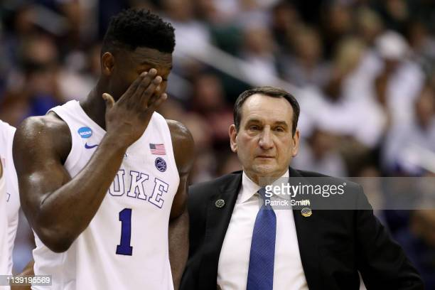Zion Williamson and head coach Mike Krzyzewski of the Duke Blue Devils talk against the Virginia Tech Hokies during the first half in the East...
