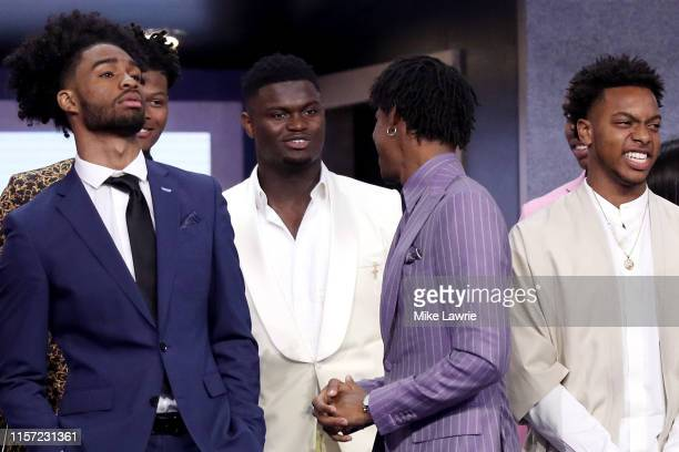 Zion Williamson and Ja Morant speak on stage before the start of the 2019 NBA Draft at the Barclays Center on June 20, 2019 in the Brooklyn borough...