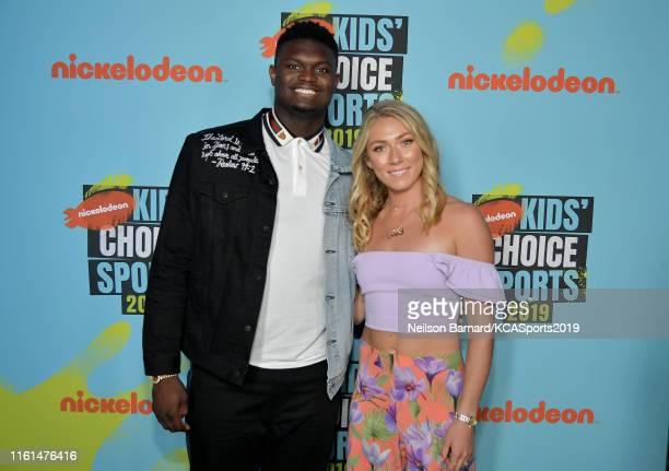 Zion Williamson and Mikaela Shiffrin attend Nickelodeon Kids' Choice Sports 2019 at Barker Hangar on July 11 2019 in Santa Monica California