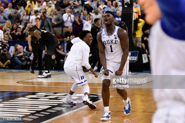 Zion Williamson and Mike Buckmire of the Duke Blue Devils celebrate following their 7776 win against the Central Florida Knights during the second...