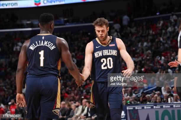 Zion Williamson and Nicolo Melli of the New Orleans Pelicans hifive during the game against the Memphis Grizzlies on January 31 2020 at FedExForum in...