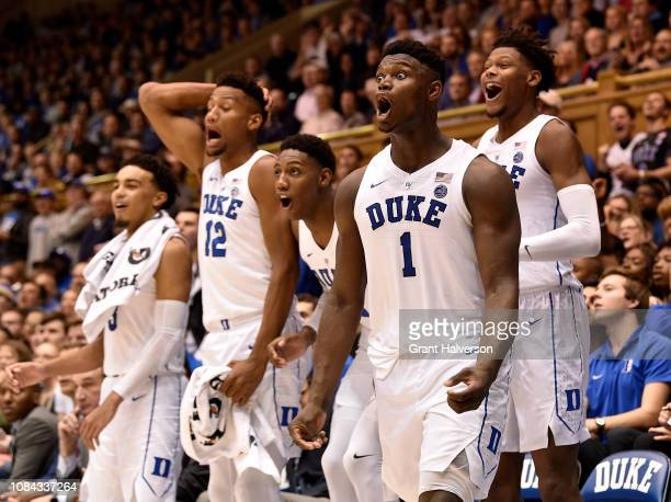Zion Williamson and the Duke Blue Devils bench react to a dunk by the reserves during the second half of their game against the Princeton Tigers at...