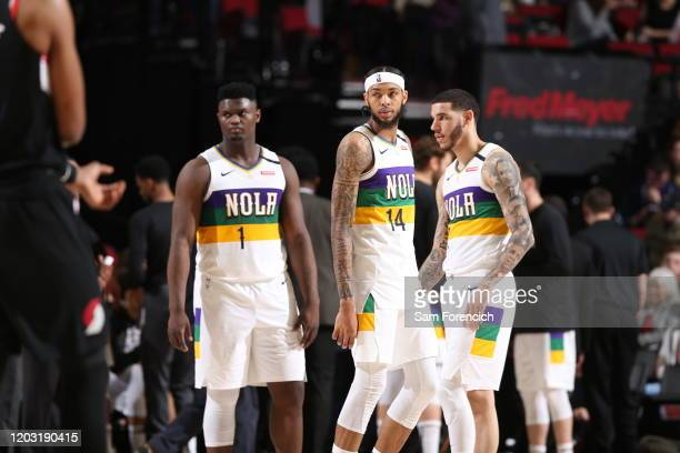 Zion Williamson, Brandon Ingram, and Lonzo Ball of the New Orleans Pelicans look on during the game against the Portland Trail Blazers on February 21...
