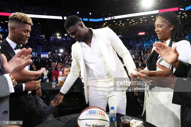 Zion Williamson celebrates with family after being selected first overall by the New Orleans Pelicans during the 2019 NBA Draft on June 20, 2019 at...