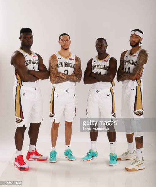 Zion Williamson Lonzo Ball Jrue Holiday and Brandon Ingram of the New Orleans Pelicans pose for a portrait on September 30 2019 at the Ocshner Sports...