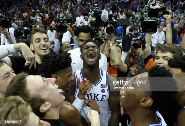 Zion Williamson of the Duke Blue Devils and teammates celebrate their 7363 victory over the Florida State Seminoles in the championship game of the...
