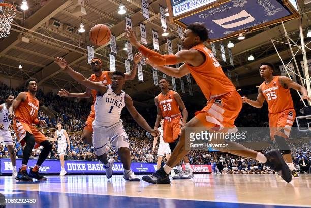 Zion Williamson of the Duke Blue Devils battles Paschal Chukwu and Elijah Hughes of the Syracuse Orange for a loose ball during their game at Cameron...