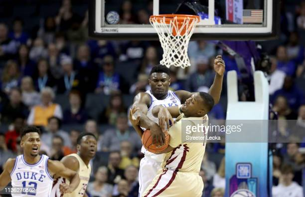 Zion Williamson of the Duke Blue Devils blocks a shot by Raiquan Gray of the Florida State Seminoles during the championship game of the 2019 Men's...