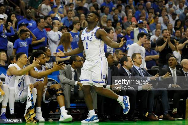Zion Williamson of the Duke Blue Devils celebrates a basket against the UCF Knights during the first half in the second round game of the 2019 NCAA...