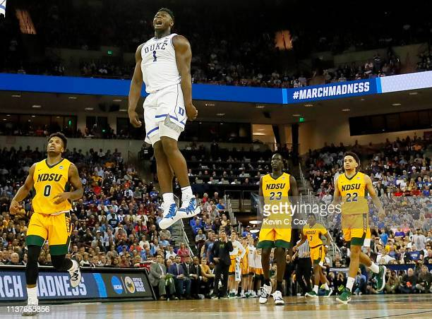 Zion Williamson of the Duke Blue Devils celebrates a dunk by teammate RJ Barrett against the North Dakota State Bison in the second half during the...