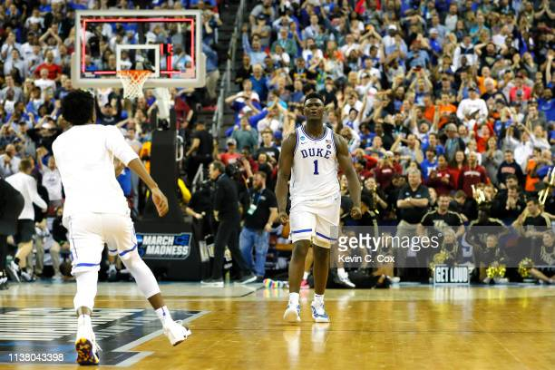 Zion Williamson of the Duke Blue Devils celebrates after defeating the UCF Knights in the second round game of the 2019 NCAA Men's Basketball...