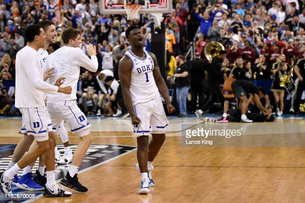 Zion Williamson of the Duke Blue Devils celebrates with his teammates following their 7776 win against the Central Florida Knights during the second...