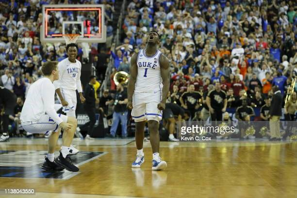 Zion Williamson of the Duke Blue Devils celebrates with his teammates after defeating the UCF Knights in the second round game of the 2019 NCAA Men's...